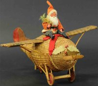 Unknown Wood-Figures Santa pilot on wicker airplane. This...