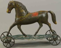 Brown George Tin-Figures Gold-colored horse with a red...