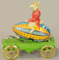 Meier Tin-Penny Toy Easter bunny rides on an Easter egg,...
