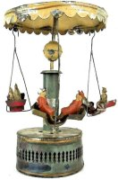 Guenthermann Tin-Carousels Tin carousel wind-up toy with...