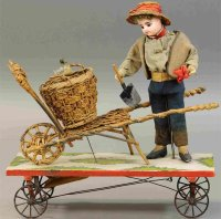 Unknown Tin-Automata Peasant boy with cart, charming pull...