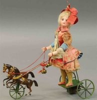 Vichy Tin-Automata Girl riding horse cart. Depicts girl...