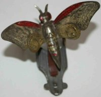 Unknown Tin-Penny Toy Early butterfly, he flaps his wings...