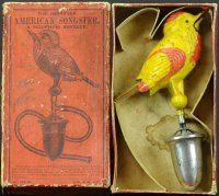 Secor Jerome Cast-Iron Figures Whistling bird with box,...