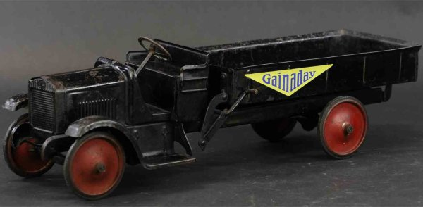 Murray Tin-Trucks GMC open dump truck, painted in black with red disc wheels,